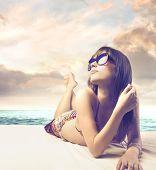 Beautiful woman sunbathing at the seaside