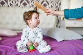 Mom Combes A Small Child. Mother Hand Brushing With A Comb His Adorable Baby Hair, Mom Taking Care O poster