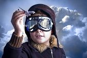stock photo of fighter plane  - Little boy in the pilot - JPG