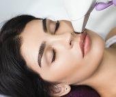 Pretty Brunette Woman Getting Hair Removing On Face. Procedure Laser Epilation. Say No To The Female poster