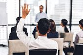 Businessman Standing In Front Of Group Of People In Consulting Meeting Conference Seminar And Showin poster