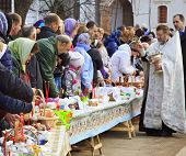 ISTRA, RUSSIA - APRIL 14, 2012: Easter cakes and eggs consecration in the  New Jerusalem Monastery on April 14, 2012 in Istra, Moscow oblast, Russia.