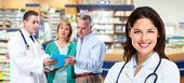 stock photo of antibiotics  - Pharmacist and a senior couple in pharmacy - JPG