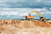 picture of boom-truck  - wheel loader excavator machine loading dumper truck at sand quarry - JPG