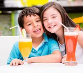 Happy kids at the diner drinking juice
