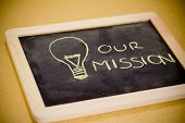 stock photo of policy  - lighbulb and business mission chalk design on blackboard - JPG