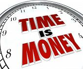 The saying or quote Time is Money on a white clock to symbolize the value and fleeting nature of time