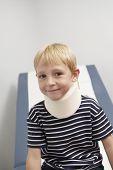Portrait of happy little boy wearing neck brace