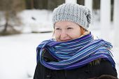 Wrapped In Scarf Woman Looking At Distance