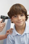 picture of otoscope  - Doctor checking boy - JPG