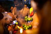 KUALA LUMPUR - JANUARY 27: A Hindu priest pierces the back of a devotee with skin hooks before his w