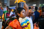 KUALA LUMPUR - JANUARY 27: A Hindu devotee carries a milk pot or 'pal kodum' as offerings to Lord Mu