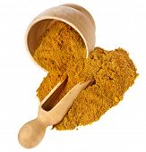 mortar with curry powder spice isolated on white
