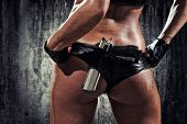 stock photo of gunshot  - sexy woman with hand gun - JPG