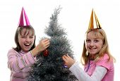 Two Sisters Dressing The Christmas Tree