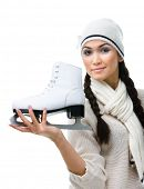 Pretty female figure skater shows one skate in hand, isolated on white