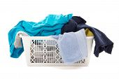 Dirty Clothes In A Laundry Basket Isolated On White