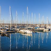 Sailing Boats Lie In The Harbor Marina Rubicon