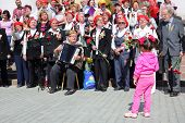MOSCOW - MAY 9: Veterans sing near Bolshoi theater, on May 9, 2013 in Moscow, Russia.  Every year on