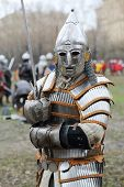 MOSCOW - APR 28: Warrior in armor with sword at Battle of East - Russia-Orda XI-XV centuries on Mane