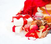 foto of blanket snow  - Christmas still life with a Christmas decorations cookies and presents nestling in fresh snow