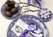 Purple Theme Easter Dinner, Breakfast Or Brunch Table Setting With Chocolate Bunny Rabbit, And Sugar