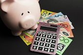 Savings And Money Management Concept With Australian Dollar Notes, Pink Calculator And Piggy Bank Ag