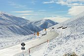 Road Through Snowy Mountains. Crown Range Road, South Island, New Zealand