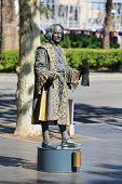 BARCELONA, SPAIN - APRIL 17 Human statue dressed as Christopher Columbus performing on La Rambla on