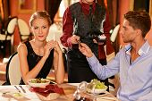 pic of recipe card  - Beautiful young couple paying with card in a restaurant - JPG