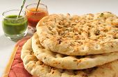 image of pakistani  - A traditional and hot Pakistani and Indian bread with sauces - JPG