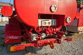 The Rear Of Old Red Fire Truck With Water Pump Equipment