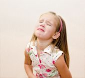 pic of disobedient  - Portrait of disobedient crying little girl at home - JPG