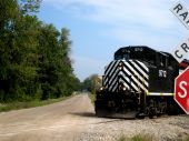 image of chug  - A Black train passing by on a beautiful day - JPG
