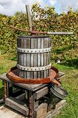 foto of wine-press  - Antique wooden wine press left outside - JPG