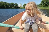 Little Blond Girl Rowing On The Boat