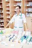 pharmacist chemist woman with drugs in pharmacy drugstore warehouse