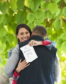 stock photo of proposal  - Outdoor photo of young couple embracing after marriage proposal - JPG