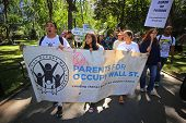 Parents for occupy wall street enter the park