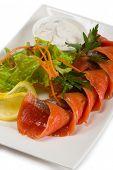 Sockeye salmon in spicy brine, lemon and salad.