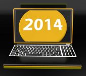 Two Thousand And Fourteen On Laptop Shows New Year Resolution 2014