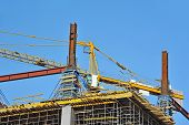 stock photo of formwork  - Concrete formwork and crane on construction site - JPG