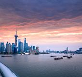 Shanghai Skyline With Huangpu River At Dusk