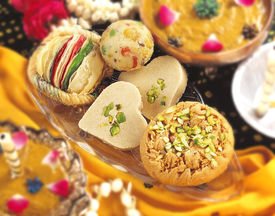 pic of mithai  - Delicious, fresh and unique verity of Asian mithai & jewelry on ground ** Note: Soft Focus at 100%, best at smaller sizes - JPG