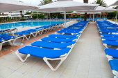 Beach chairs and parasols by the swimming pool