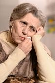 Senior woman with tooth pain