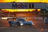 Sebring, FL - Mar 15, 2014:  The Telcel Ford EcoBoost travels through turn one at sunset during the