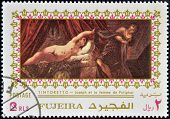 FUJEIRA - CIRCA 1985: Stamp printed in Fujeira shows Joseph and Potiphar's wife by Tintoretto