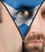 Unzipping Face To Flag Of Scotland