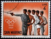 SAN MARINO - CIRCA 1964: A stamp printed in San Marino shows different athletes